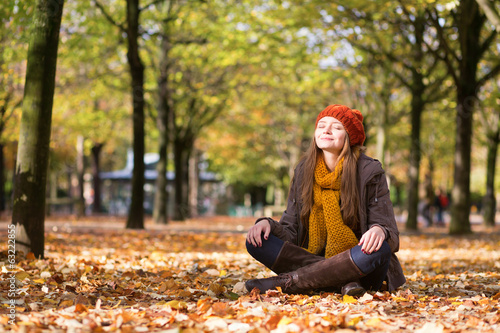 Girl relaxing and meditating in park