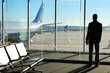 Businessman Waiting his Flight in Airport Terminal. Silhouette