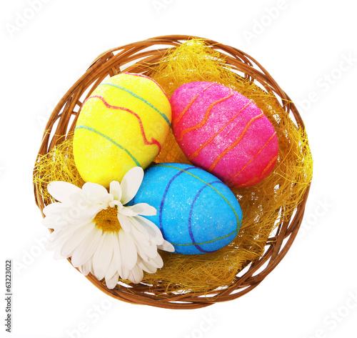 Happy Easter. Colorful Glitter Eggs with Chamomile Flower