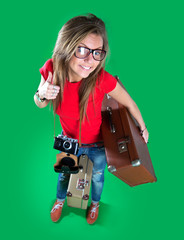 Woman traveler with a camera, green background