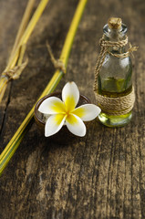 frangipani in bowl and massage oil with dry grove