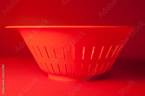 Orange kitchen strainer