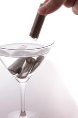 isolated of old AA battery in wine glass with hand is energy con