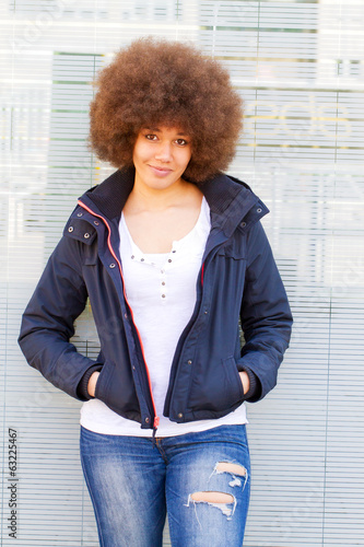 Portrait of young woman with afro hair cut
