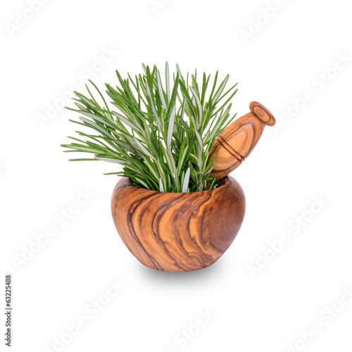 Fresh rosemary herb in wooden mortar