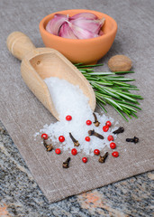 Peppercorn mix in wooden scoop, herbs and spices