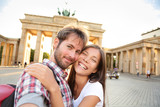 Happy couple selfie, Brandenburg Gate, Berlin