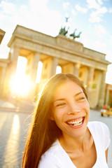 Happy laughing woman at Brandenburg Gate, Berlin
