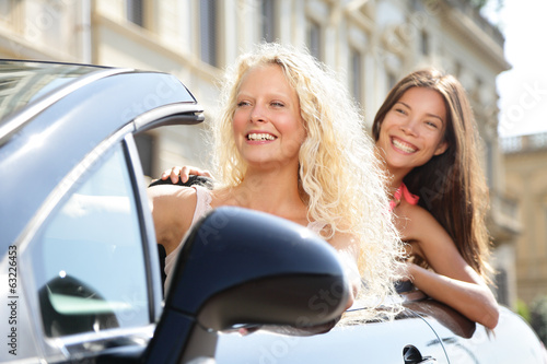 Car driver woman driving with girl friends