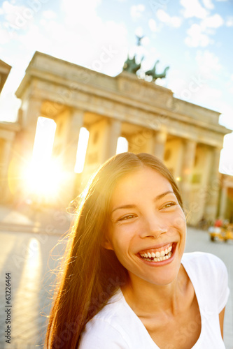 Happy laughing woman at Brandenburg Gate, Berlin