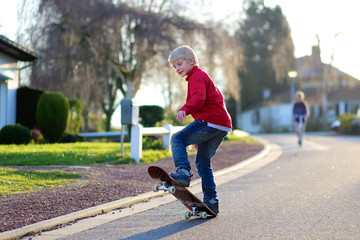 Happy boy having fun with skate board on the street