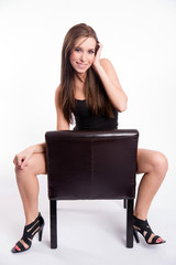 Stunning Young Beautiful Barefoot Woman Straddles Black Leather