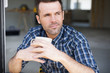 Portrait of construction worker drinking coffee outdoors