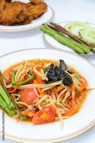 "Papaya spicy salad named ""Som Tum"", Thai food with fried chicken"