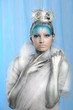 Model with artistic make up posing as Ice Queen or Snow Fairy