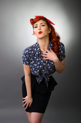 Pin up girl blowing a kiss
