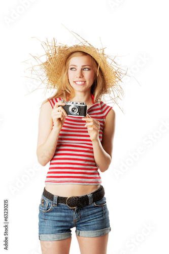 Woman in beachwear taking pictures