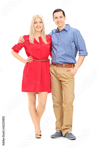 Full length portrait of husband and wife posing