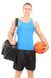 Male basketball player carrying a sports bag