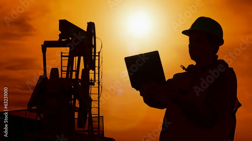 Silhouette worker and oil pump