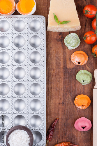 Multicolored ravioli on a wooden board
