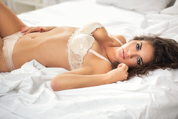 sexual girl lie on white sheet