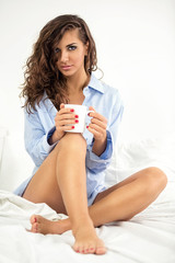Woman with coffee in morning
