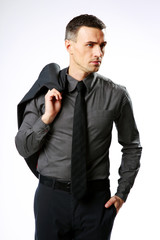 Pensive businessman standing and holding jacket