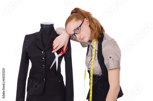 Young tailor isolated on white background