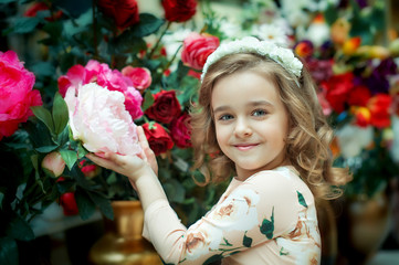 Cute little girl holding a flower.