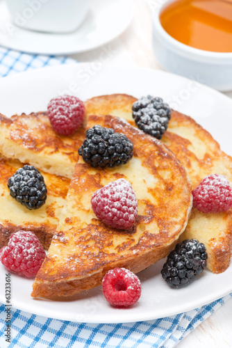 French toast with fresh berries and powdered sugar, vertical