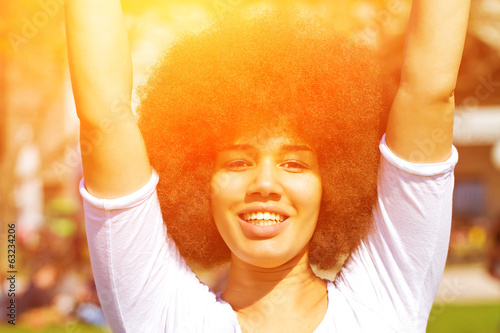 Young woman with afro hair cut in the sun