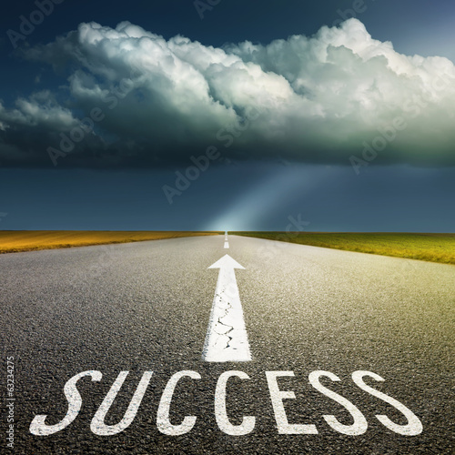 Empty asphalt road and signs symbolizing success