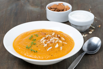 plate of carrot soup with almonds and cress salad