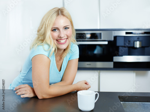 Happy woman in her kitchen