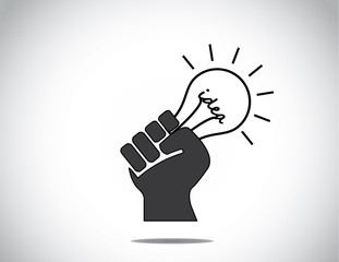 human hand fist holding idea light bulb of success concept