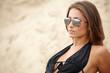 A beautifull caucasian girl lying on the sand,