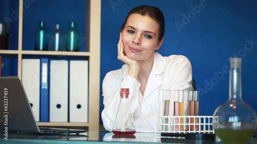 Portrait of young beautiful female scientist in laboratory