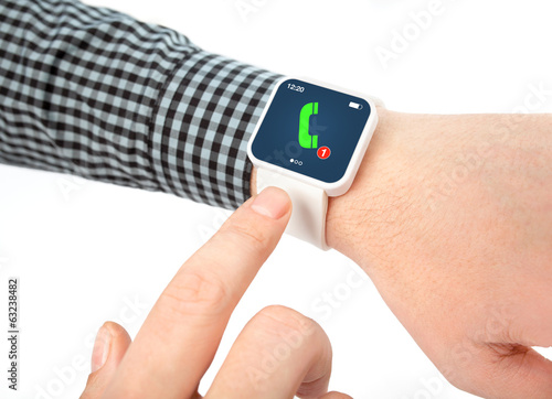 Isolated male hands with smartwatch with phone call on the scree