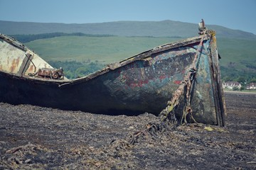 Wrecked boat in Fort William, Scotland, United Kingdom