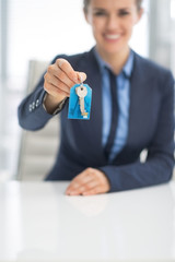 Closeup on happy business woman giving keys