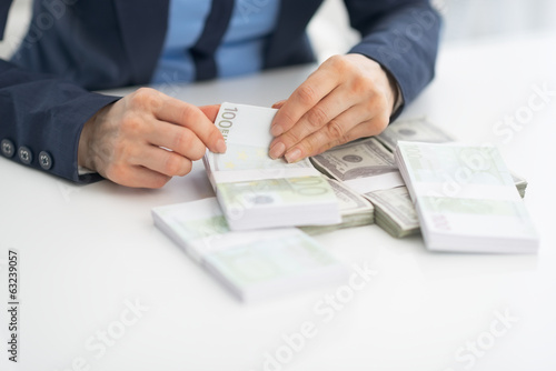 Closeup on business woman counting money