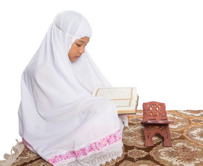 Young Muslim Girl In White Hijab Reading Al Quran