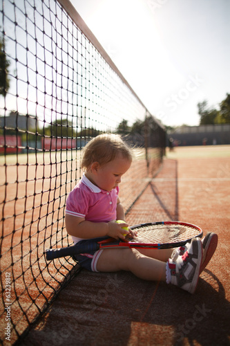 canvas print picture little girl plays tennis