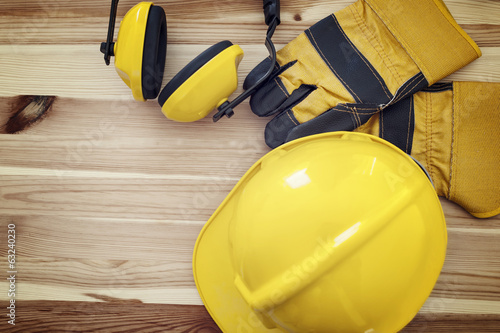 Protective wear for construction worker on wooden plank