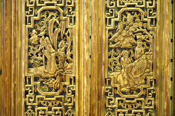 Pattern of people carved on wood door