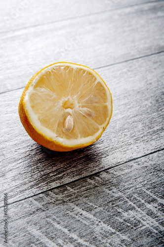 Half Lemon on old wooden table