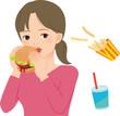 ハンバーガーを頬張る若い女性