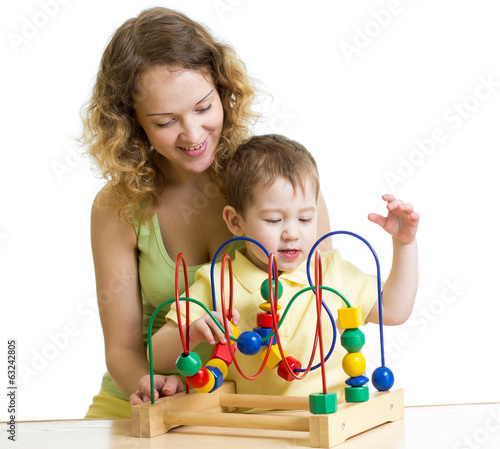 kid boy and mom play with color educational toy