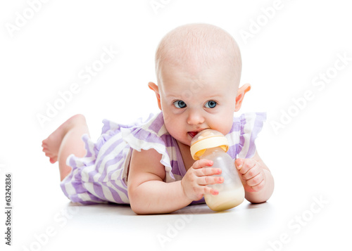 adorable child drinking from bottle. 7 months old girl.